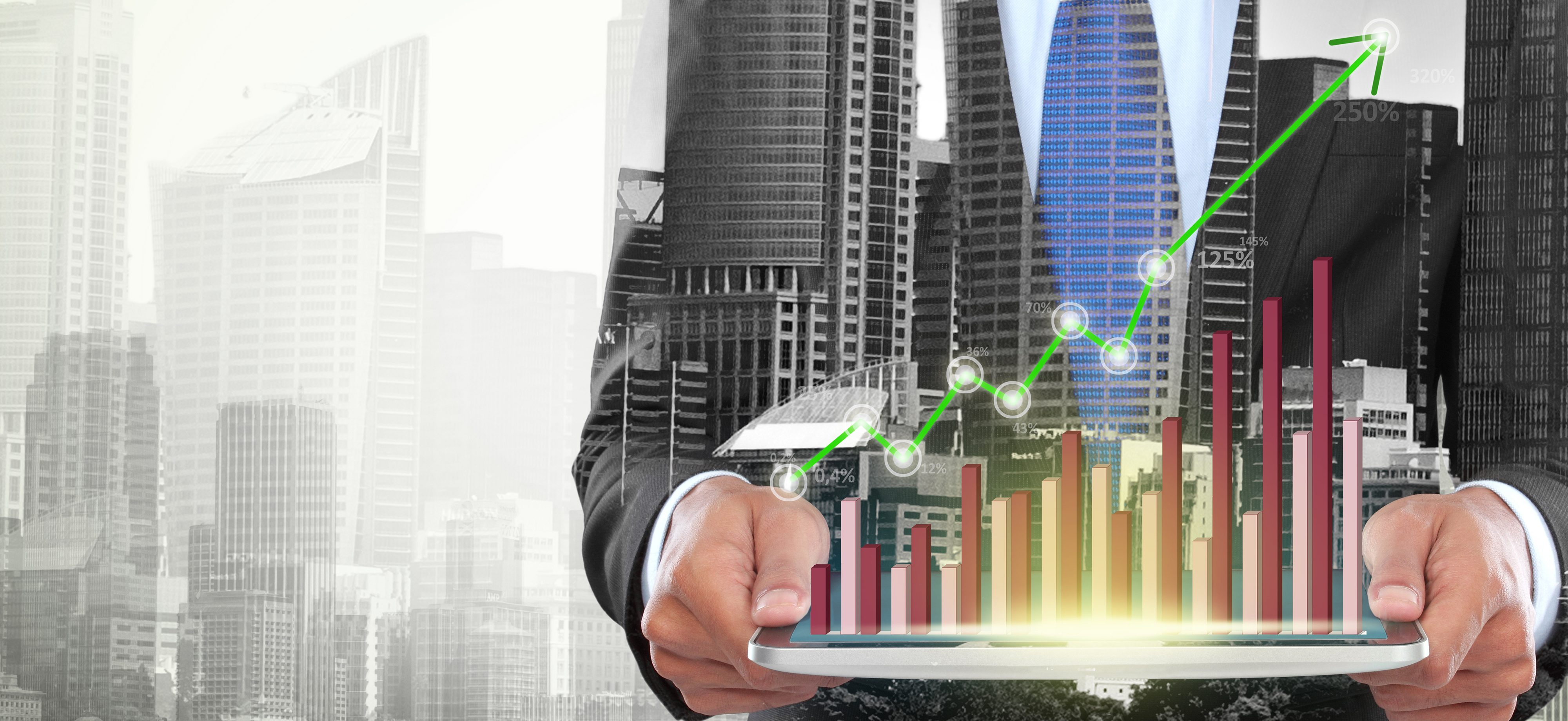 Double exposure of city and businessman using hightech digital tablet